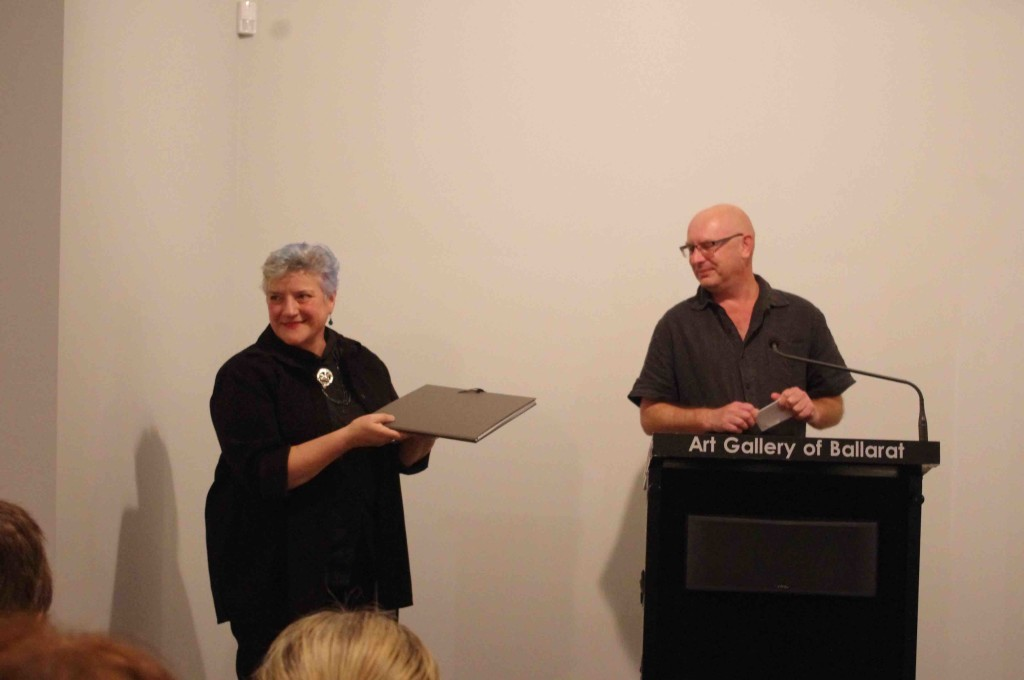 Mark Graver presents the folio to the Art Gallery of Ballarat